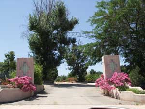 Blue Sky Ranch entrance gate with bougainvillea